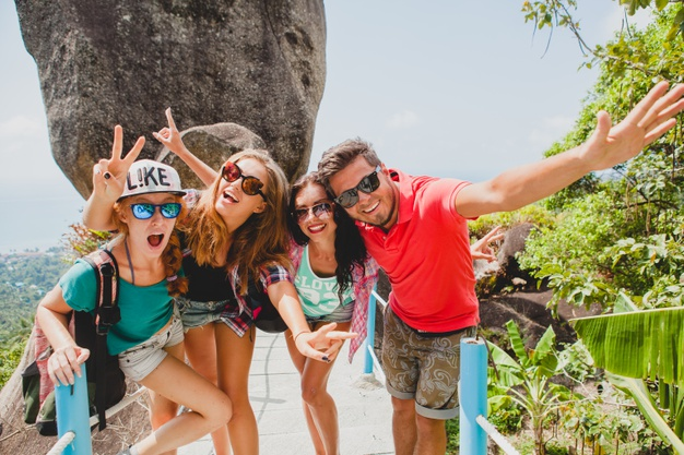 Happy hipster company of friends traveling around world Free Photo