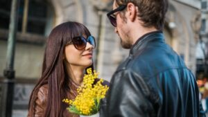115f2b9e-e92c-4f04-b0fe-c356ebd5548b-attractive-couple-meets-for-date-with-flowers.jpg